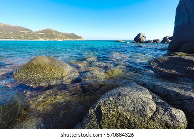 Beautiful shot of a seascape in Sardinia, Italy, with rocks in clear water at Solanas bay