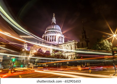 Beautiful shot of St paul cathedral in London taken using Long exposure with double decker red bus passing and creating long light trails