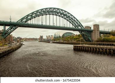 A beautiful shot of Tyne Bridge running over a river in Newcastle, UK