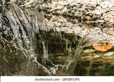 A beautiful shot of water splash in the river in Tostock, Wasser village, Germany - Shutterstock ID 1892891395