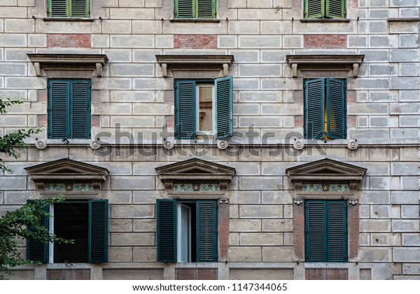 Beautiful shuttered windows in a side street near St Peter's Cathedral in Rome, Italy