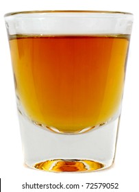 Beautiful side on shot of a shot glass full of brown whiskey or brandy