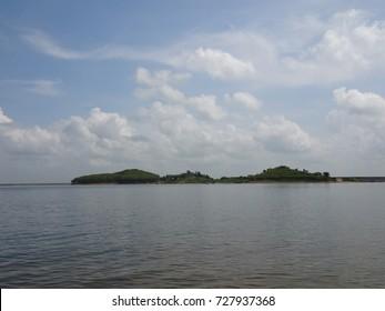 Beautiful silhouette coast line , waving water blue sky white cloud  / Mukutmanipur, Bankura, West Bengal, India