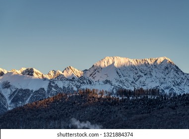 Beautiful silhouette morning landscape of mountains massif on North Caucasus on winter resort