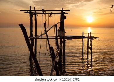Beautiful silhouette sunrise at tropical sea