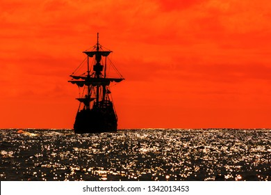 Beautiful silhouette view of a replica of the Santa Maria tallship of Columbus, sailing the Atlantic ocean around Madeira island in summer at sunset