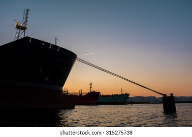 Beautiful silhouettes from big bulk carriers moored in port. Photo's taken during sunset.