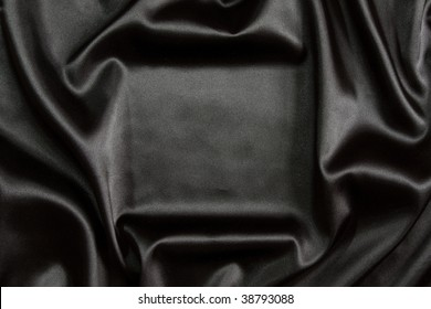 Beautiful silky brilliant black wavy fabric