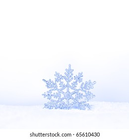 beautiful silver snowflake in snow