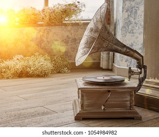 Beautiful silver vintage phonograph. Retro gramophone with copy space. Toned