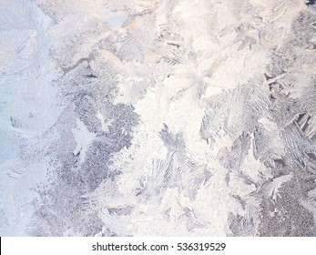 Beautiful silver winter background with crystal frost patterns