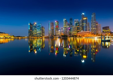 Beautiful Singapore cityscape at dusk. Landscape of Singapore business building around Marina bay. Modern high building in business district area at twilight and night.Effect Photo by long exposure.
