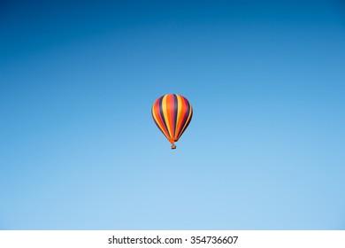 Beautiful single balloon in blue sky