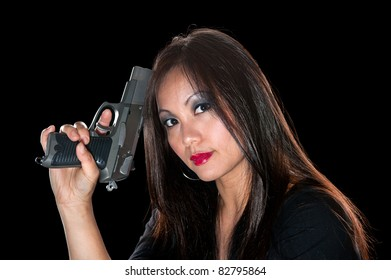 A beautiful, sinister Asian woman holding a pistol.