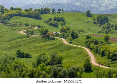 Beautiful sinuous road in Bucovina rural area, Romania