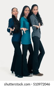 Beautiful sisters doing different expressions in different sets of clothes: confidence