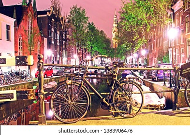 The beautiful sity landscape with bike on the bridge in evening Amsterdam