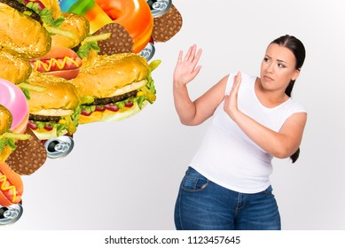 beautiful size plus model girl saying no to junk food girl kicking off hamburger sugar  junk food health concept