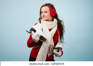 Beautiful skater wearing a ear muffs and white scarf, horizon format