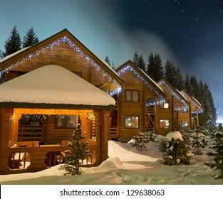 Beautiful ski chalets at night