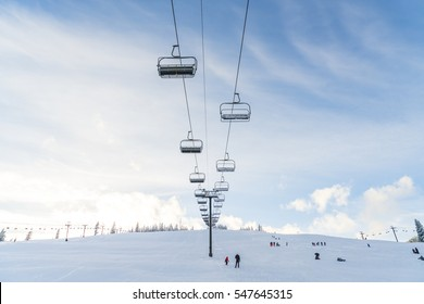 beautiful ski lift over snow mountain in ski resort with blue sky background.