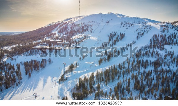 Beautiful Pyhätunturi ski resort in the sun in early spring when skiing season is on it best