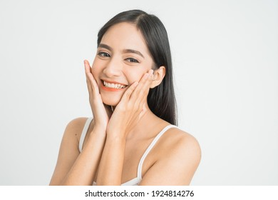 Beautiful Skin care woman Face smile to you with white background. asian Beauty