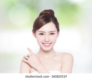 Beautiful Skin care woman Face smile to you with nature green background. asian Beauty