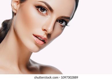 Beautiful skin face woman brunette hair natural makeup plastic surgery. Studio shot.
