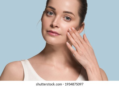 Beautiful skin healthy woman face with manicure nails hand touching healthy clean fresh skin