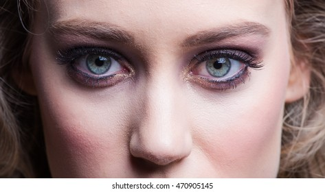 Beautiful Skinny Blond beauty model with lovely fair skin and smokey eyes.