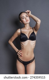 Beautiful and skinny model wearing black lingerie and posing
