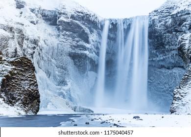 Beautiful Skogafoss waterfall. Iceland. Winter view.