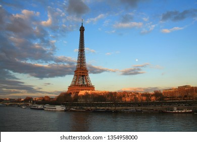 Beautiful sky above the Eiffel tower, the seine and river boats. Paris, capital and the most populous city of France