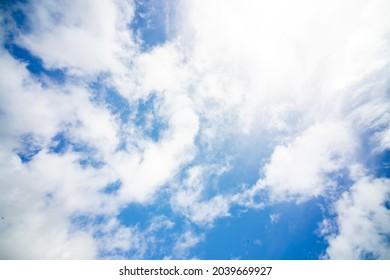 Beautiful sky background. Unusual cirrus clouds in the blue sky