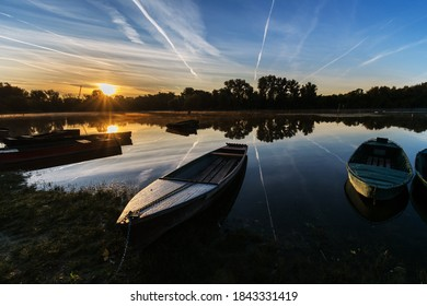 Beautiful sky with chemtrails  in the nature above an Serbia in sunrise time, and  boat on a Danube river