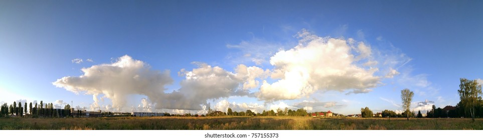 beautiful sky with clouds over the countryside, panorama
