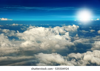 Beautiful sky and clouds, view from a flying plane, background