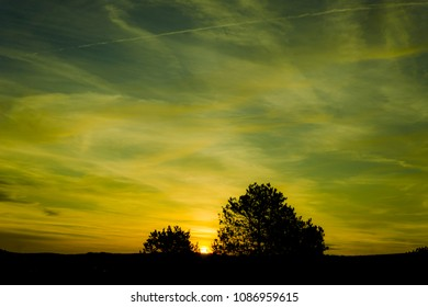 beautiful sky, colorful sunset, green and blue clowds
