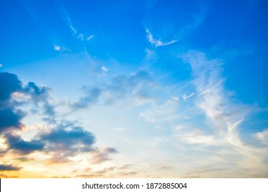 Beautiful sky during sunset over tropical island. Blue sky with white and overcast fluffy cloud and glowing orange light in evening. Cloudy sky. Cloudscape and skyscape at Lipa Noi beach, Samui island