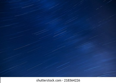 Beautiful sky at night with star trails. Earth's rotation hurls the stars into motion