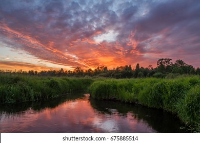 Beautiful sky over the river at sunset