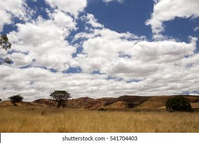 Beautiful sky over the wavy deforested landscape of northwest Madagascar