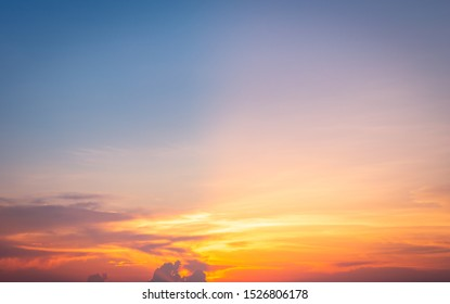Beautiful sky painted by the sun leaving bright golden shades.Dense clouds in twilight sky in winter evening.Image of cloud sky on evening time.Evening sky scene with golden light from the setting sun