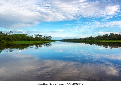 Beautiful sky reflected in a river in the Amazon rain forest near Iquitos, Peru