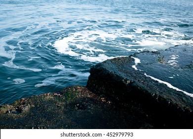 Beautiful sky sea stone and sand beach