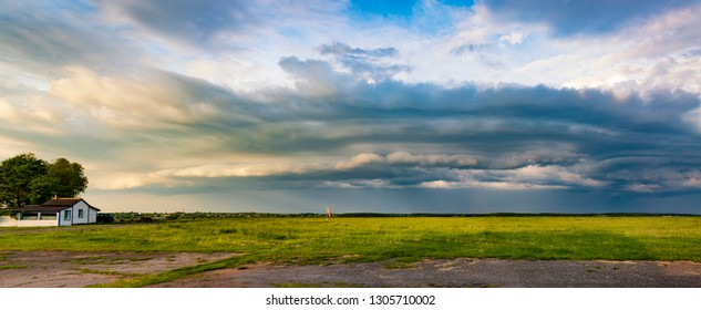 Beautiful sky and small airfield. Vibrant sunset panorama, high resolution