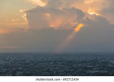 Beautiful sky with sun through the clouds at sunset.