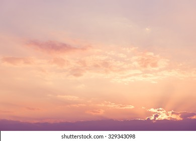 Beautiful sky with the sunlight. Sky before night time with sunrise in purple tone. Spectacular view of a sunset above the clouds from airplane window. the nice sky before early morning.