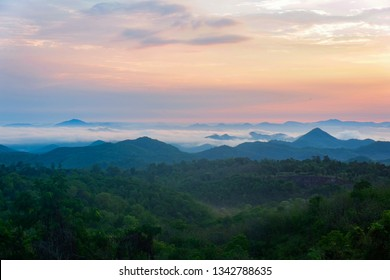 Beautiful sky sunrise asia landscape on hill with fog mist in the morning background